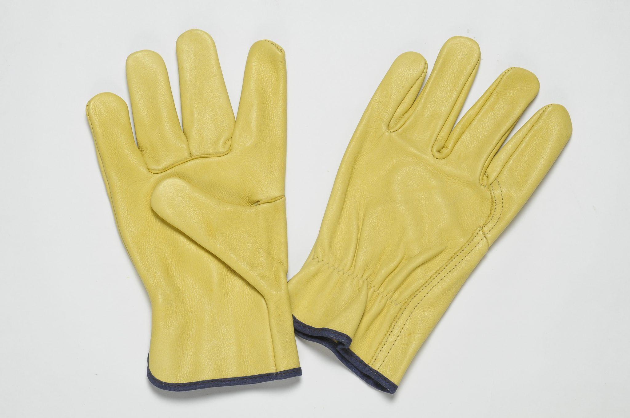 YELLOW GRAIN LEATHER WITH RETURN ON FOREFINGER, ADJUSTIBLE ELASTIC IN THE WRIST, COLOURED BINDING