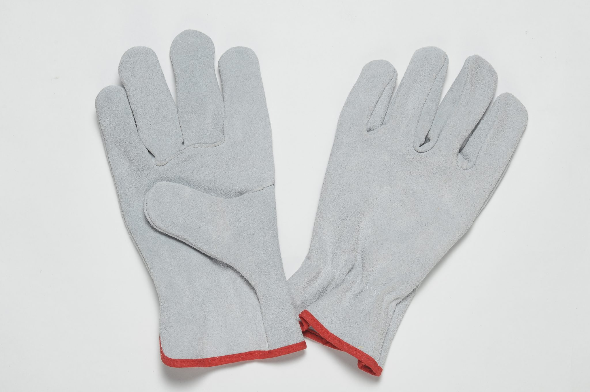 NATURAL SPLIT GLOVES WITH ADJUSTABLE ELASTIC IN THE WRIST, COLOURED BINDING